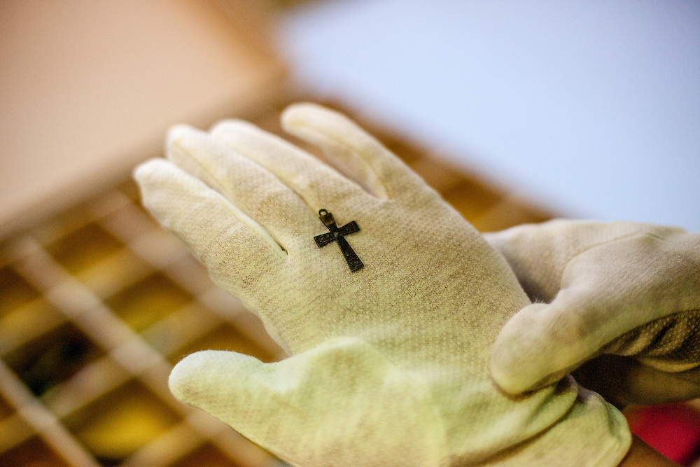 A cross at the storage room and archive for items  from prisoners deported to the Auschwitz Nazi Concentration camp. The cross was made by a prisoner while being in the camp and donated later by the prisoner or his family to the Auschwitz memorial. All objects are registered and catalogued.