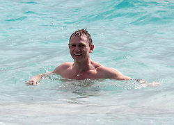 """File picture of Daniel Craig at Salines Beach enjoying St Barts lifestyle. The island was a paradise until September 6, 2017. Hurricane Irma left a trail of """"absolute devastation"""", destroying houses, snapping trees and killing at least eight persons as it tore across the tiny Caribbean island of St Barts on Wednesday with 185-mile-per-hour winds. Photo by Papixs/ABACAPRESS.COM"""