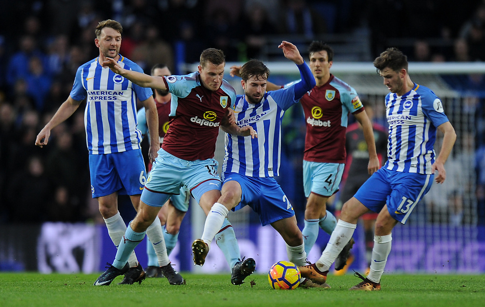 Burnley's Chris Wood battles for possession with Brighton & Hove Albion's Davy Propper<br /> <br /> Photographer Ashley Western/CameraSport<br /> <br /> The Premier League - Brighton and Hove Albion v Burnley - Saturday 16th December 2017 - The Amex Stadium - Brighton<br /> <br /> World Copyright © 2017 CameraSport. All rights reserved. 43 Linden Ave. Countesthorpe. Leicester. England. LE8 5PG - Tel: +44 (0) 116 277 4147 - admin@camerasport.com - www.camerasport.com