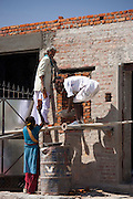 Men and women work on construction site in Jawali village in Rajasthan, Northern India