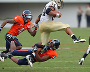 Sept. 3, 2011 - Charlottesville, Virginia - USA; Virginia Cavaliers cornerback Chase Minnifield (13) tackles William & Mary Tribe running back Jonathan Grimes (34) during an NCAA football game at Scott Stadium. Virginia won 40-3. (Credit Image: © Andrew Shurtleff