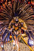 Dancer on a float in the Carnaval parade of Grande Rio samba school in the Sambadrome, Rio de Janeiro, Brazil.