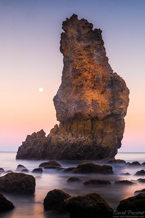Emerging rocks in Lagos coast at moonrise.