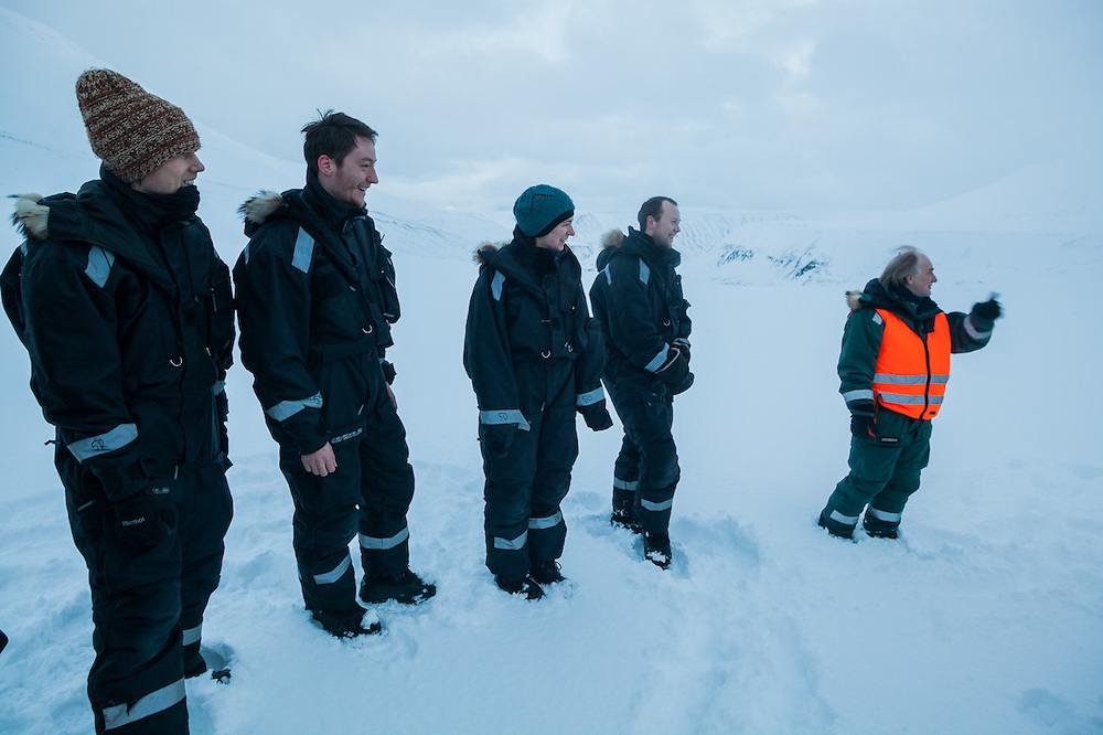 UNIS professor Doug Benn lectures his students about glaciers at the foot of Scott Turnerbreen, Svalbard.