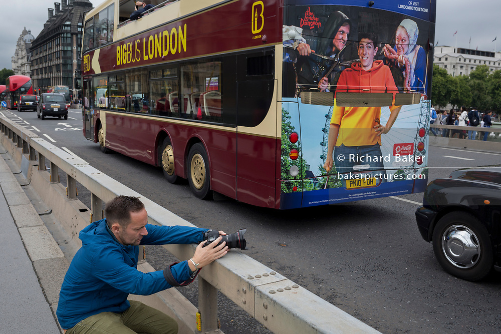 Photographer Jeremy Sutton-Hibbert, on Westminster Bridge, on 21st August 2017.