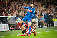 Conor McLaughlin of Sunderland FC steps over Luke Freeman of Sheffield United during the EFL Cup match between Sheffield United and Sunderland at Bramall Lane, Sheffield, England on 25 September 2019.