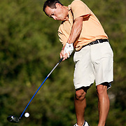 HUNTINGTON BEACH, CA - Aug 10, 2005:  David Ping practices his golf game at Hacienda Heights golf course on August 10, 2005. (Photo by Todd Bigelow/Aurora)