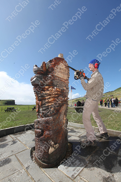 """Shane Gilmore pictured on Tuesday with his Sculpture that he is refurbushing for Herritage Week at the Cliffs of Moher , Co. Clare titled """"The Cliffs Of Moher Expierence"""" made of Oak.<br /> Pic. Brian Arthur/ Press 22."""