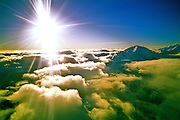 Sunlight above the clouds and mountains in Denali N.P., Alaska