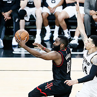 01 May 2017: Houston Rockets guard James Harden (13) goes for the layup past San Antonio Spurs guard Danny Green (14) during the Houston Rockets 126-99 victory over the San Antonio Spurs, in game 1 of the Western Conference Semi Finals, at the AT&T Center, San Antonio, Texas, USA.