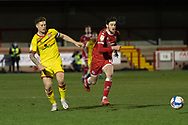 Walsall defender James Clarke (#5) is chased by Crawley Town forward Ashley Nadesan (#10) during the EFL Sky Bet League 2 match between Crawley Town and Walsall at The People's Pension Stadium, Crawley, England on 16 March 2021.