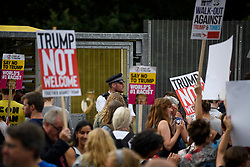 © Licensed to London News Pictures. 12/07/2018. London, UK. Anti Trump Protestors gather near the residence of the U.S Ambassador in Regents Park in London on the day the U.S President Donald Trump arrives in the UK for the start of a four day visit. President Trump, who is due to stay at Winfield House in Regent's Park, will meet The Queen and British Prime Minster Theresa May before heading to Scotland at the weekend.  Photo credit: Ben Cawthra/LNP