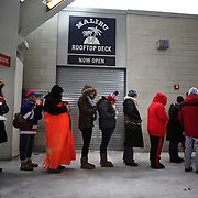 Women queue for the toilet on a bitterly cold day at Yankee Stadium during the New York Rangers Vs New Jersey Devils NHL regular season game held outdoors at Yankee Stadium, The Bronx, New York, USA. 26th January 2014. Photo Tim Clayton