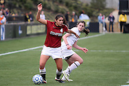 04 December 2011: Stanford's Alina Garciamendez (4) and Duke's Kelly Cobb (right). The Stanford University Cardinal defeated the Duke University Blue Devils 1-0 at KSU Soccer Stadium in Kennesaw, Georgia in the NCAA Division I Women's Soccer College Cup Final.