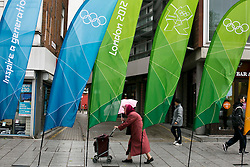 © Licensed to London News Pictures.08/062012.Stratford, London UK..Olympic Street Dressing unveiled..Stratford Broadway was the first place to receive the London 2012 branded street dressing for this summers Olympics games Photo credit : Andrew Baker/LNP