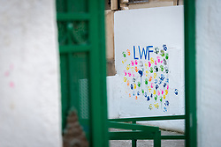 17 February 2020, Zarqa, Jordan: The letters 'LWF' followed by children and other community members' handmarks decorate a wall of the Lutheran World Federation community centre in Zarqa.