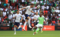 England's Gary Cahill (centre) and Nigeria's Odion Jude Ighalo (right) battle for the ball