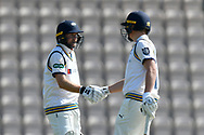 50 for Adam Lyth of Yorkshire -Adam Lyth of Yorkshire celebrates scoring a half century and is congratulated by Gary Ballance of Yorkshire during the Specsavers County Champ Div 1 match between Hampshire County Cricket Club and Yorkshire County Cricket Club at the Ageas Bowl, Southampton, United Kingdom on 11 April 2019.