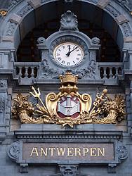 Ornate clock at Antwerp central railway station in Belgium