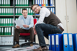 Businessmen busy sorting filing office meeting