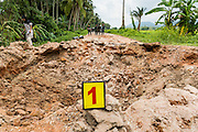 08 JULY 2013 - MAYO, PATTANI, THAILAND:  The crater left by an IED used to attack Thai soldiers in Pattani Monday. Eight Thai soldiers were injured - one seriouly and seven with minor injuries - when their truck was hit by an IED outside Mayo, Pattani province in southern Thailand Monday. The soldiers were returning from a teacher protection mission when their truck ran over the explosive. The attack was thought to be conducted by Muslim insurgents who have been battling the Thai government for greater autonomy. The conflict in southern Thailand has claimed about 5,000 lives since 2004.   PHOTO BY JACK KURTZ