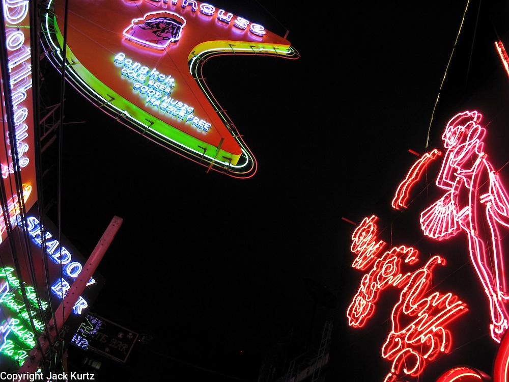 Mar. 21, 2009 -- BANGKOK, THAILAND: Neon signs advertising adult businesses on Soi Cowboy in Bangkok, Thailand. Photo by Jack Kurtz