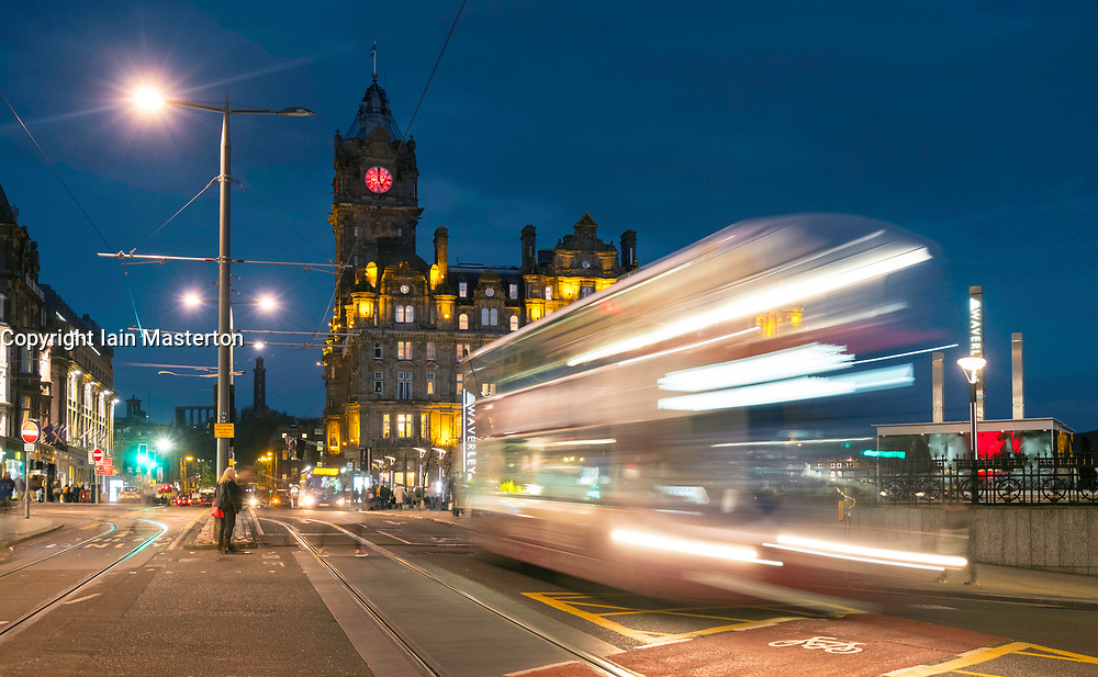 Night view of Princes Street in Edinburgh with traffic on long exposure in Scotland, United Kingdom.