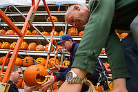 Brennen Lorden and Steve StPierre load pumpkins on to the Tower Friday afternoon for Saturday's Pumpkin Fest.  (Karen Bobotas/for the Laconia Daily Sun)