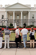 Tourists and onlookers gather outside the White House following the release of the Starr Report September 12, 1998 in Washington, DC.