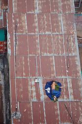 Man Sleeping On Rooftop