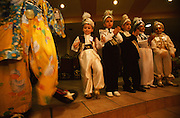 Boys about to be circumcised at Kemal Özkan's Circumcision Palace in Istanbul, Turkey, dance together with a clown. This is one of the many fun activities used to make the boys relax before the actual circumcision takes place. As custom dictates, the boys are dressed up as small sultans or princes.