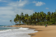 People walking in the sand stretch in Taipu de Fora beach, in the brazilian state of Bahia. The long sand stretch is a inviting for a walk, running, biking or just to relax. Diego Murray / 4SEE