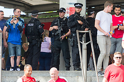 © Licensed to London News Pictures. 27/05/2017. London, UK. Armed policemen patrol as Arsenal and Chelsea football fans arrive at Wembley stadium for the Emirates FA Cup football finals on May 27, 2017. The security level was in response to Manchester Arena bombing when 22 people died and 55 people were injured in one of the most deadly attacks in the UK. Photo credit: Ray Tang/LNP