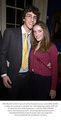 MR BRUNO LACEY son of writer Robert Lacey and MISS ISABEL CHICK at a party in London on 18th February 2002.OXP 30