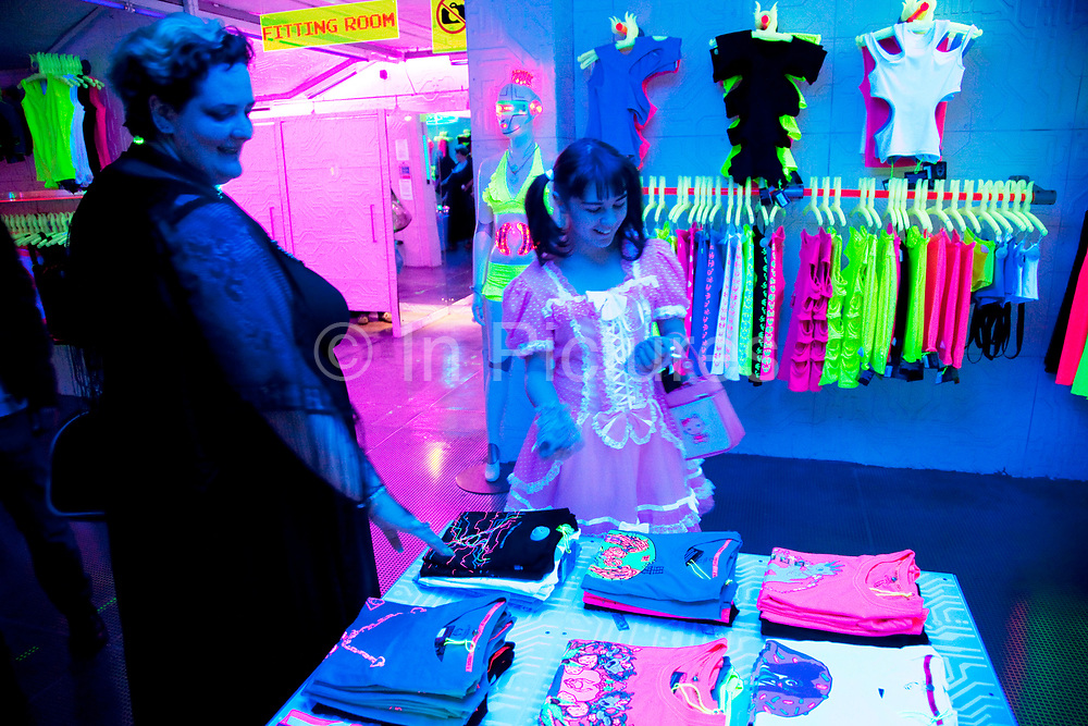 Mother Louise Irwin-Ryan with her daughter Georgia (11, wearing a pink Lolita dress) and son Kiefer (8, wearing a red Liverpool Football Club kit) spending a day out together in Camden Town, North London. The family go to their favourite shop 'Cyberdog' where everything on sale is futuristic and glowing. Louise is on various benefits to help support her family income, and housing, although recent government changes to benefits may affect her family drastically, possibly meaning they may have to move out of London. Louise Ryan was born on the Wirral peninsula in 1970.  She moved to London with her family in 1980.  Having lived in both Manchester and Ireland, she now lives permanently in North London with her husband and two children. Through the years Louise has battled to recover from a serious motorcycle accident in 1992 and has recently been diagnosed with Bipolar Affective Disorder. (Photo by Mike Kemp/For The Washington Post)