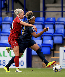 Liverpool Women's Kirsty Linnett (left) and Manchester United Women's Lauren James battle for the ball during the Continental Tyres Cup, Group Two North match at Prenton Park, Birkenhead.