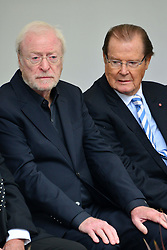 Michael Winner public memorial.  <br /> (L-R) Sir Michael Caine, Sir Roger Moore during the Memorial.<br /> Memorial takes place at the National Police Memorial. The film director and food critic helped establish, following his death on January 23 2013. <br /> Geraldine Winner, Sir Michael Parkinson, Sir Michael Caine, Sir Roger Moore, Cilla Black, Carol Vorderman, Sir Terence Conran, give eulogies, <br /> London, United Kingdom<br /> Sunday, 23rd June 2013<br /> Picture by Nils Jorgensen / i-Images