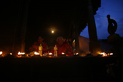 August 14, 2017 - Bhaktapur, Nepal - Women pray as they light oil lamps at a temple on the last day of the eight-day long Gai festival in Bhaktapur, Nepal on Monday, August 14, 2017. (Credit Image: © Skanda Gautam via ZUMA Wire)