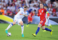2016.06.20 Saint Etienne<br /> Pilka nozna Euro 2016<br /> mecz grupy B Slowacja - Anglia<br /> N/z Juraj Kucka Wayne Rooney<br /> Foto Norbert Barczyk / PressFocus<br /> <br /> 2016.06.20 Saint Etienne<br /> Football UEFA Euro 2016 group B game between Slovakia and England<br /> Juraj Kucka Wayne Rooney<br /> Credit: Norbert Barczyk / PressFocus