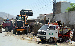 August 21, 2017 - Pakistan - QUETTA, PAKISTAN, AUG 21: Heavy machinery removes garbage at garbage dump during .cleanliness drive under the supervision of Metropolitan Corporation in Quetta on Monday, .August 21, 2017. (Credit Image: © PPI via ZUMA Wire)