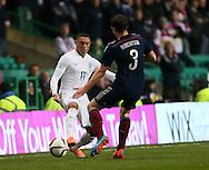 Scotland's Andrew Robertson tussles with England's Alex Oxlade-Chamberlain<br /> <br /> - International Friendly - Scotland vs England- Celtic Park - Glasgow - Scotland - 18th November 2014  - Picture David Klein/Sportimage