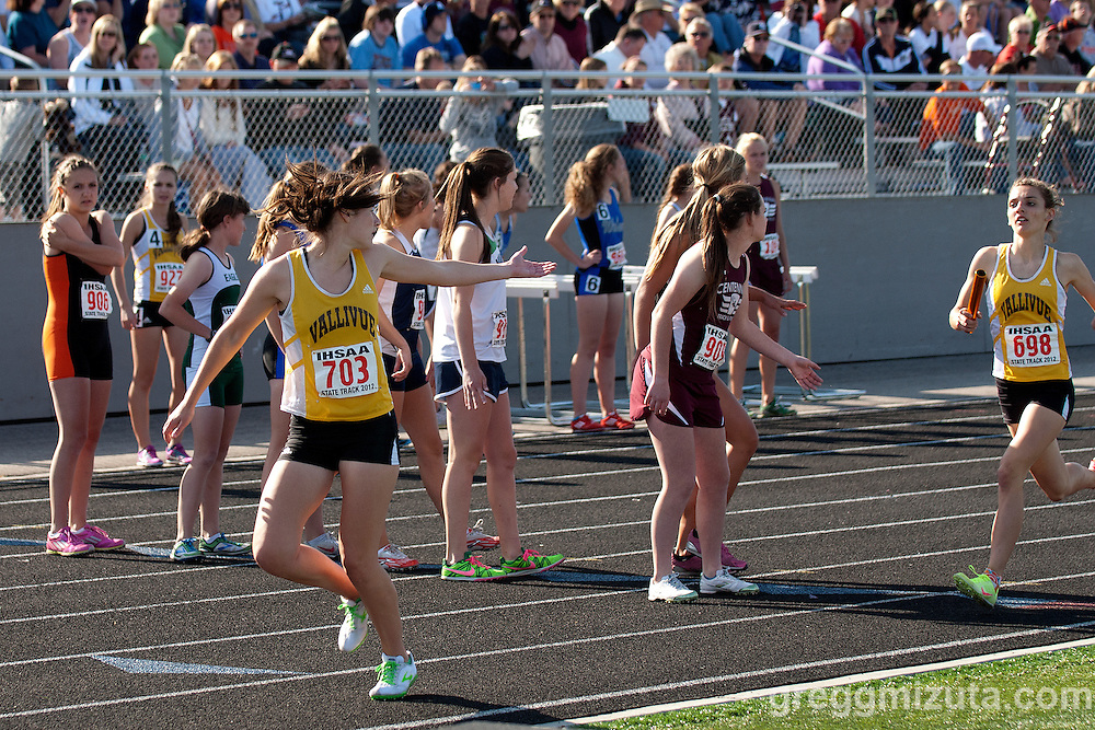 Vallivue's Cheryn Trapp waits for the baton from Mikayla Malaspina in the 4x800 at the 5A Idaho Track and Field Championships on May 18, 2012 at Rocky Mountain High School, Meridian, Idaho.