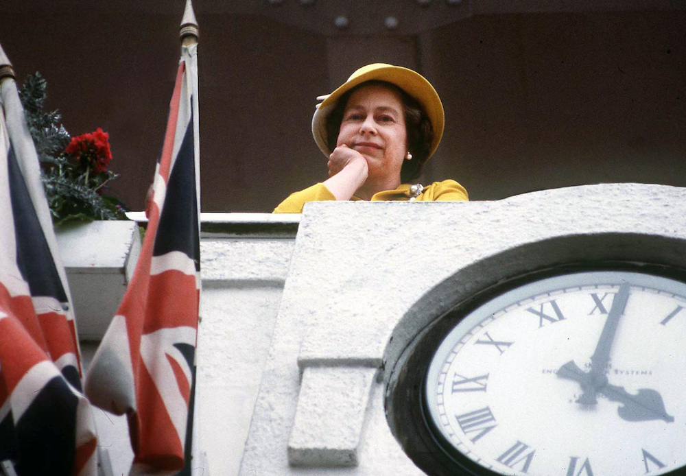 The Queen waiting for the races to start at the Epsom Derby,UK. Photograph by Jayne Fincher