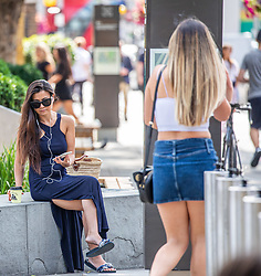 © Licensed to London News Pictures. 22/07/2020. London, UK. Shoppers relax in the sunshine on the King's Road in Chelsea as they get ready for Friday when masks become compulsory in shops in England. Photo credit: Alex Lentati/LNP