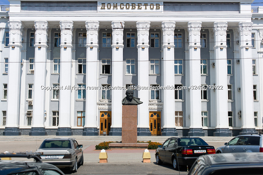 """20150826  Moldova, Transnistria, Tiraspol. Statue head of Lenin in front the<br /> """"House of the Soviets"""", built 1956 in Stalin's Empire style, houses today the City Council of Tiraspol as well as the authorities of the country"""