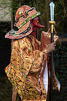 Tengu at Mengake Kamakura - Mengake or Masked Parade at Goryo Jinja shrine.  At this festival held in September a group of ten people take part in this annual ritual: 8 men and 2 women. Wearing comical or grotesque masks that signify different demons, legends and dieties  leave the shrine and parade through the nearby streets accompanied by portable shrine and festival music.