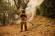 Scott Weems, a local civilian, defends homes threatened by the Glass Fire in Napa Valley, CA on September 29, 2020. Weems and other teams of locals have banded together to assist fire fighters and defend homes as the wildfire remains at 0% containment since it began three days ago and now threatens more than 10,000 structures.