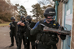 Sussex Police Armed response team prepare to enter a building