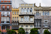 Buildings in Seville Spain feature square facades, symmetrical design and stone or cement structure.