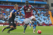 Aly Cissokho of Aston Villa (R) in action with Matt Ritchie of Bournemouth.<br /> Barclays Premier League match, Aston Villa v AFC Bournemouth at Villa Park in Birmingham, The Midlands on Saturday 09th April 2016.<br /> Pic by Ian Smith, Andrew Orchard Sports Photography.